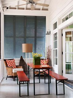 shutters on a screened in porch give privacy and shade. This is a perfect solution!