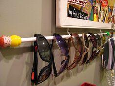curtain rod as sunglasses or glasses organizer