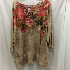 Maggie Barnes for Catherines 3/4 sleeve top 3X. Tan with multi color flowers 3/4 sleeve top. The brand is Maggie Barnes for Catherines. It is a size 3X. Catherines Tops
