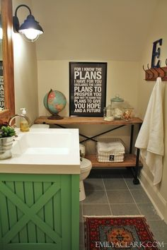 Converting a closet into the boys' bathroom (painted green vanity, industrial shelving/console)