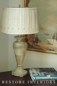 Why not paint a lamp?!!!!!  Replace the shade and paint away the ugliness.  Now it's cute!  ASCP