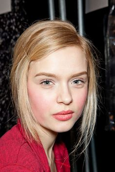 Lipstick pulls double-duty as a concentrated cherry red lipstick is mixed with a drop of foundation on the apples, swirling it around with a makeup sponge to channel an après-ski kind of look.