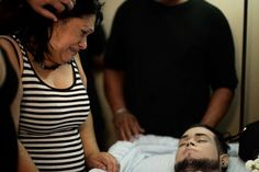 Lucyvette Padro mourns at her son's wake: Angel Candelario Padro was one of the 23 Puerto Ricans killed in Orlando, FL, June 2016. In all, 49 were killed, 53 injured, the deadliest mass shooting in recent history. A week later, Senate GOP voted down passage of gun reform measures and left in June for their July 4 break. (AP Photo/Carlos Giusti)