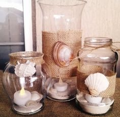 Decorating beachy vases and jars with burlap and shells...table centerpieces