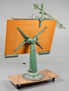 "RITBORD, Nike, Eskilstuna, omkring 1900-talets mitt.  Nike Drafting Table - Sweden 1940 - This restored drafting table was made by Nike Hydraulics in Eskilstuna, Sweden. The base is made from nickel plated steel and has a hydraulic mechanism. It pivots, angles and moves up and down to a minimum height of 3' and a maximum of 4'-2"". It includes a 40"" × 60"" acrylic top"