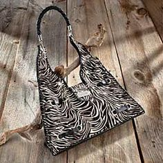 zebra print leather purse (which would go excellently with those umbrellas. AAAHH)