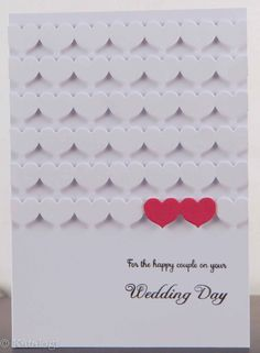 Love the pops of red hearts on this mostly white, clean and classic handmade wedding card.