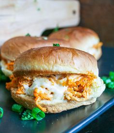 buffalo chicken sliders are made with shredded chicken, wing sauce, seasonings, cheese, and ranch dressing piled onto a slider bun and baked. they're easy, delicious, and perfect for any party! buffalo chicken sliders   a flavor journal
