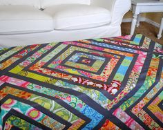 I muststill be on a color craving kick, because my latest project has bucketloads.  Thisquilttop is madefrom a jelly roll ofAmy Butle...