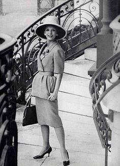 Dress by Nina Ricci and handbag by Henry a la Pensee, 1960.