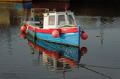 Reflections of Pibbin in Ramsey Harbour - © Peter Killey