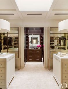 The dressing room of Nashville philanthropists and photography collectors Jennifer and Billy Frist features light fixtures by Charles Edwards.  Pin it.