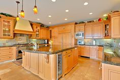 Traditional Kitchen with Flush, simple granite tile floors, High ceiling, Complex Granite Tile, Undermount Sink, Custom hood