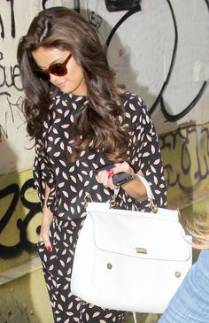 Selena Gomez- makes me want my hair long again! Love her outfit too!