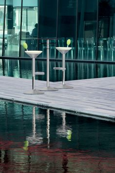 MANHATTAN stool, a design of Itamar Harari, 2008..shape of a cocktail glass complete with olive.. painted steel structure with non-scratch finish and integral polyurethane seat and lumbar backrest lever, which is used to regulate the height of the seat.