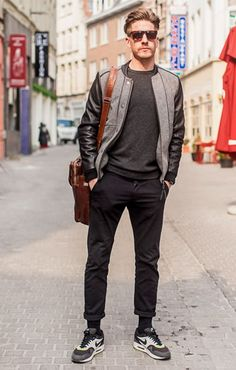 He's got all the elements of masculinity casual: runners, casual sweater, comfortable trousers and some very cool shades.  This look is effortlessly cool. || Sighting: Antwerp