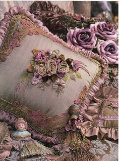 beautiful purple dusy silk roses, antique-styled ruffled pillows with floral appliques - very feminine with French boudoir look.