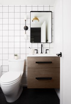 bathroom with wood vanity, black mirror, and black grout Interior Shutters, Home Interior, Interior Decorating, Bathroom Light Fixtures, Bathroom Lighting, New York Brownstone, Black Grout, New Staircase, Apartment Makeover