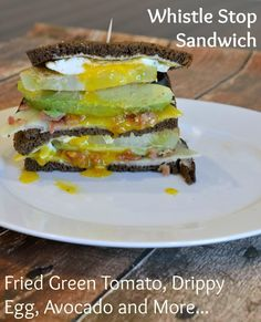 Whistle Stop Sandwich Recipe- this AWARD WINNING RECIPE uses fried drippy egg, avocado, cornmeal crusted green tomato, cheddar and bacon on soft pumpernickel. You will dream about this sandwich!