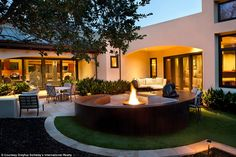 Bliss: The expensive property has plenty of space to host family and friends for a night of fun outside around the fireplace above
