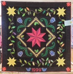 """Stars and Flowers, 74 x 81.5"""", made and quilted by Jaime Watson.   Highlights of the 2014 River City Quilters' Guild Show.  Photo by Quilt Inspiration"""