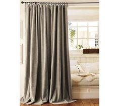 Luxurious and elegant grey velvet drapes.