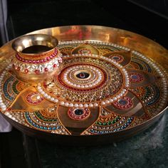 Take an arti thali with kum kum and a diya. When at the holi fire do a chandlo onto the coconut and (sprinkle rice -? Arti Thali Decoration, Kalash Decoration, Ganapati Decoration, Engagement Decorations, Diy Wedding Decorations, Handmade Decorations, Fancy Envelopes, Acrylic Rangoli, Diy Clothes And Shoes