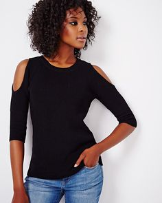 Get flirty with this cold shoulder sweater in a 3/4 sleeve. Perfect with jeans…