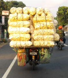 solo-jogja.  Krupuk delivery on motorbike.