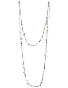 Trendy 2-in-1 necklace is an eye-catching combo of tri-tone spikes, beads and links.