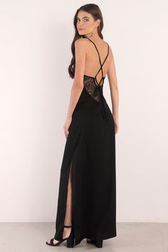 Give me your love in the Channel Freedom Maxi Dress. A maxi dress with slit that features a deep v neck and crossing back straps. Turn heads with the  #shoptobi