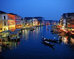 Venice at night. For the canals, the gondola rides and the lights.