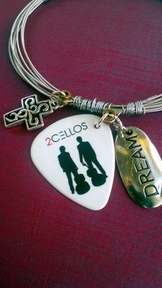 What could be better for a 2Cello fan than a Guitar string bracelet made with played guitar strings from the Las Vegas Elton John Shows, with a 2Cello pick and Charms. Made to your size.