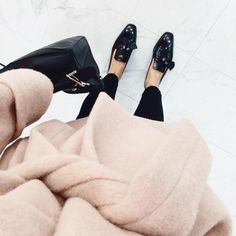"""""""Wrapped up and perfecting my puddle-jumping skills in this crazy weather with @lyst #LystFW"""""""