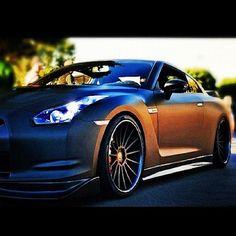 Sleek Matte Black Nissan #ferrari vs lamborghini #luxury sports cars