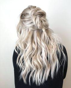 Fun braided hairstyle on beautiful long blonde hair