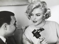 """An original vintage black and white photograph of Marilyn Monroe taken by Manfred Kreiner (1929-2005) in 1959 while Monroe was in Chicago promoting her latest film, Some Like it Hot (UA, 1959). Photographer's stamp and initialed """"MK"""" on verso."""