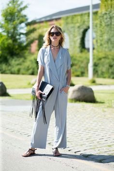 Jumpsuit with fringe clutch.