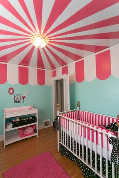 "Carnival-themed girl's nursery! The ""big top"" ceiling is amazing!"