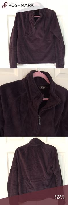 """Athleta Fleece Half Zip eggplant colored fleece half zip from Athleta. features back zip pocket and rubber toggle zip on front. 100% poly. good to very good condition with just light pilling on cuffs as seen in close-up photo. size medium. bust flat is 20"""", length is 24.5"""". Athleta Tops Sweatshirts & Hoodies"""