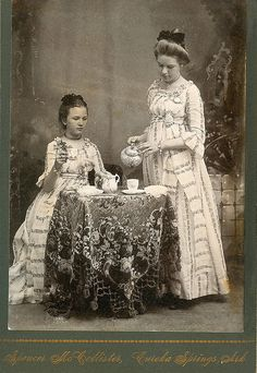 Two young women have an elegant tea party in Eureka Springs Arkansas a log time ago ! by Kingkongphoto & www.celebrity-photos.com, via Flickr