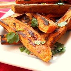 Tropical Sweet Potato Fries 2 sweet potatoes, unpeeled 2 tablespoons olive oil, or as needed salt and ground black pepper 1 tablespoon sea salt 1 teaspoons grated lime zest teaspoon chili powder teaspoon paprika teaspoon crushed red pepper flakes Food For Thought, Vegetarian Recipes, Healthy Recipes, Fast Recipes, Sweet Potato Wedges, Fried Potatoes, Sweet Potato Recipes, Food And Drink, Vegetarian Food