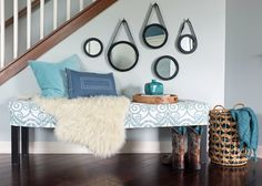 How to Style a Bench. Also DIY captain mirrors at:  http://www.tealandlime.com/2011/11/round-mirror-with-leather-strap-tutorial/