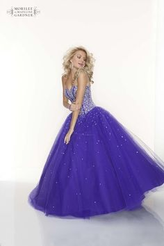 Make your fairytale evening come true in this classic princess style prom dress by Mori Lee.