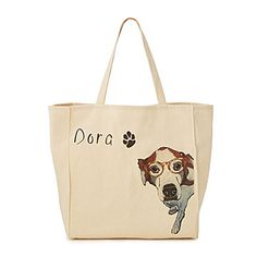 Carry a tribute to your loyal pet with this paw-sitively adorable tote bag.