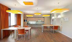 Cordaancentre in Amsterdam byOD 205 ArchitecturewithLZF Lamps'Cuad Pendantsin the break room.