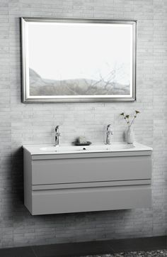 Kantate double washbasin with one big basin and 2 tapholes. Nicely combined with our handmade silver leaf faced framed mirror with built-in LED lighting.