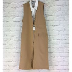 Stunning camel waistcoat shown here with our NEW white shirt dress. #new #season visit us online and instore www.pinkcadillac.co.uk Pink Cadillac, Camel, Duster Coat, Casual Outfits, Shirt Dress, Chic, Stylish, Jackets, How To Wear
