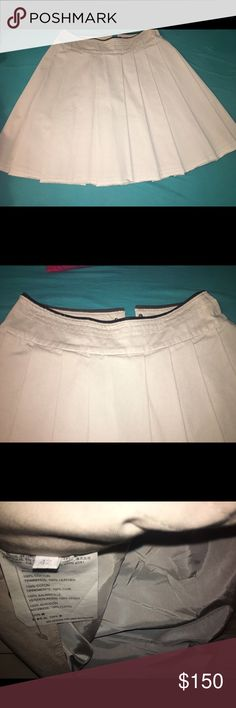 Prada Skirt Sz 42 Great Condition slight rip in the inside seam, that can be easily fixed.  Brown Leather trim on top.   Smoke and Pet free home. Prada Skirts A-Line or Full