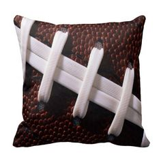 This fun throw pillow looks like it has been encased by a football! football, pigskin, sports, brown and white, bedroom, home decor $29